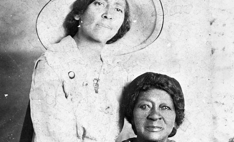 Eartha White, standing, with her mother, Clara English White